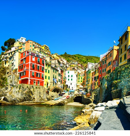 Riomaggiore village on cliff rocks and sea at sunset., Seascape in Five lands, Cinque Terre National Park, Liguria Italy Europe. - stock photo