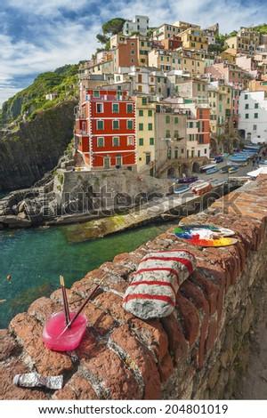 Riomaggiore village on cliff rocks and sea, Seascape in Five lands, Cinque Terre National Park, Liguria Italy Europe.  - stock photo
