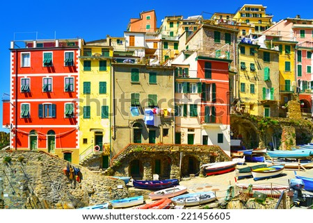 Riomaggiore village street, boats and colorful houses in Five lands, Cinque Terre National Park, Liguria Italy Europe. - stock photo