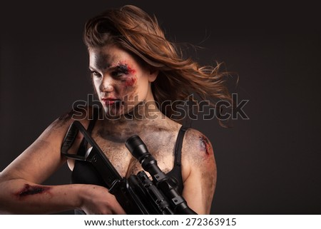 Riot girl with sniper gun close up portrait. With blood and wound on face.  - stock photo