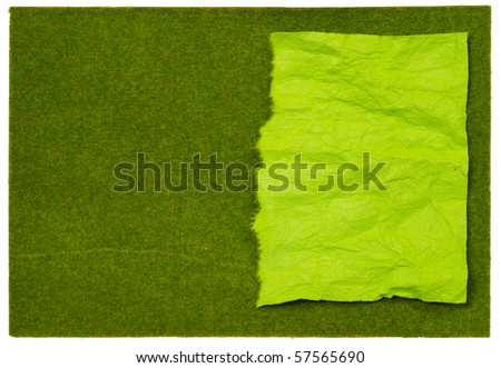 Rip Crumpled Mulberry paper on Artificial grass - stock photo