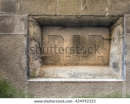 RIP, rest in peace. Old plaque in wall. Engraved effect wording. - stock photo