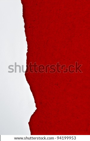 Rip white paper on red cardboard background - stock photo