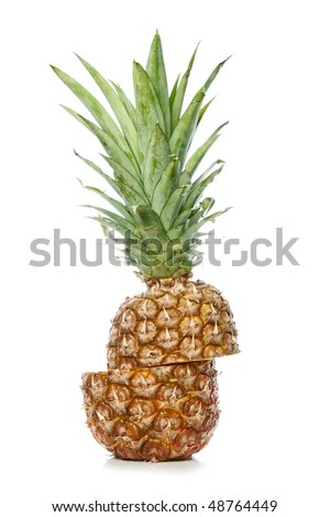 Ripe ananas fruit with green leaves isolated on white background