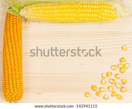 Ripe and dry corn with seeds on a wooden surface concept - stock photo