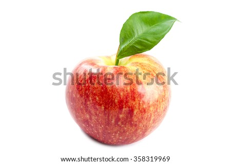 Ripe apple and green leaf isolated on white background. - stock photo