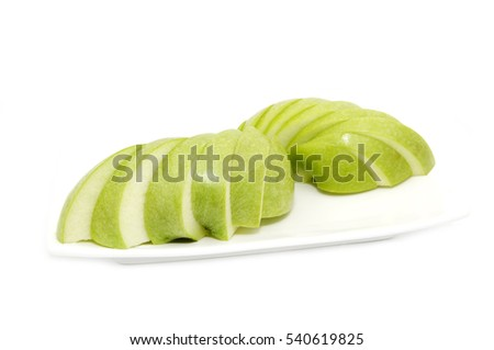 Ripe apple is sliced on a plate one on a white background