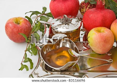 ripe apple  ,pomegranates and honey for Rosh Hashana– jewish new year - stock photo
