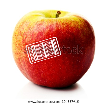 Ripe apple with barcode isolated on white - stock photo