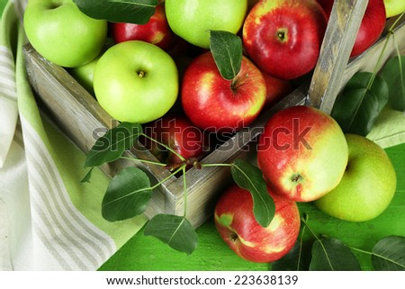 Ripe apples in crate on table close up - stock photo