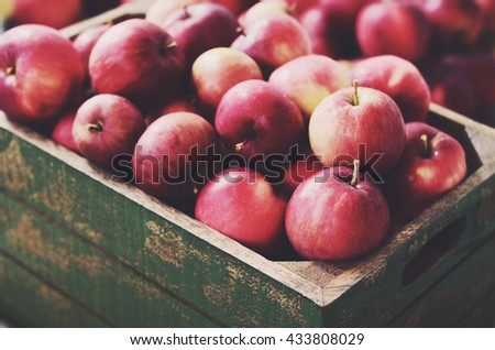 Ripe apples in rustic wooden crate  - stock photo