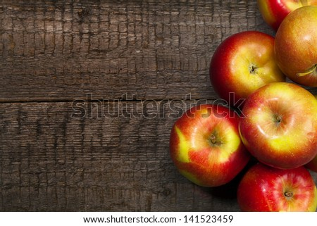 ripe apples on wooden table - stock photo