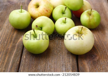 Ripe apples on wooden table close-up