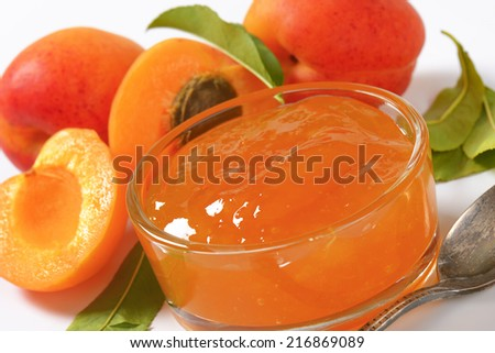 ripe apricots and bowl of apricot jam - stock photo