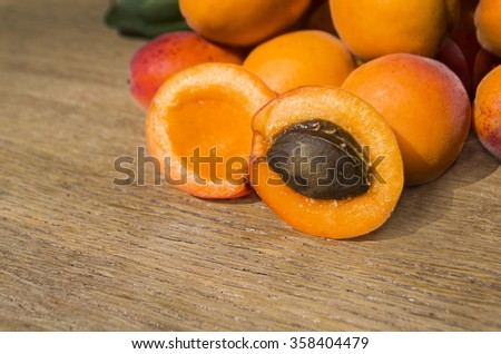 Ripe apricots. Fresh apricots  on a wooden table - stock photo