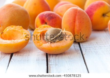 Ripe apricots fruit on white wooden table