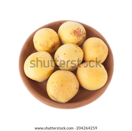 Ripe Apricots in clay bowl isolated on white background - stock photo