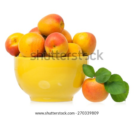 Ripe apricots in the yellow ceramic plate isolated on a white background - stock photo