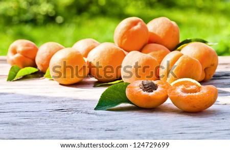 ripe apricots on a old wooden table