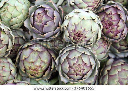 Ripe artichokes background - stock photo