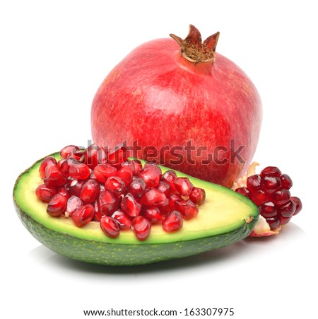 Ripe avocado and pomegranate isolated on white - stock photo