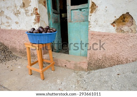 Ripe avocado for sale set in a bowl outside of the local house in Apaneca, El Salvador - stock photo