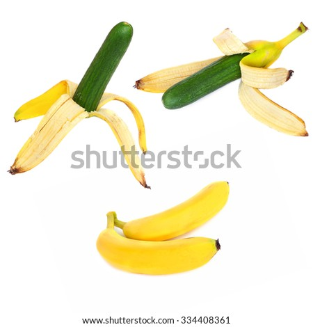 Ripe banana fruit and banana peel with a fresh cucumber instead of banana ( Banana replaced with a fresh cucumber) on a white background - stock photo