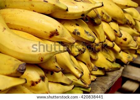 Ripe banana heap in city market  - stock photo