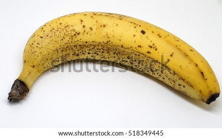 RIpe banana with black spot on white background.