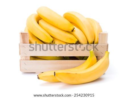 Ripe bananas in wooden box. Musa acuminata - stock photo
