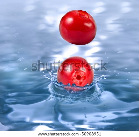 ripe berry cranberry falling in a refreshing drink - stock photo