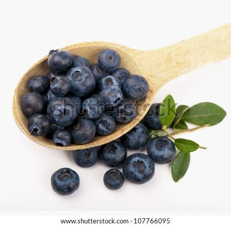 Ripe blueberries  close up on white background - stock photo