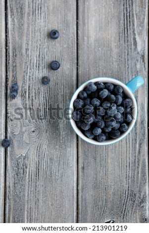 Ripe blueberries in the cup top view