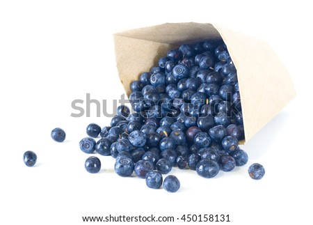 ripe blueberries scattered from a package isolated