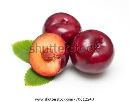 Ripe  bright plums closeup on white background - stock photo