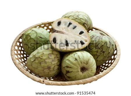 Ripe cherimoya in wicker bowl isolated over white background - stock photo