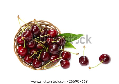 Ripe cherries in a basket isolated on a white background. - stock photo