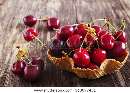 ripe cherries on the old wooden background.health and diet food. selective focus - stock photo