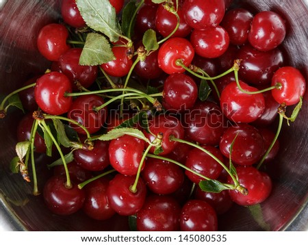 ripe cherries with stem and leaves, background