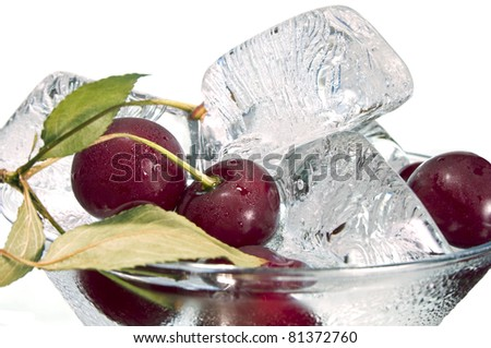 Ripe cherry and ice in  glass ( still life on  white background) - stock photo