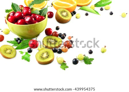 ripe cherry fruit and berries in a bowl of pistachio on a white background, space for text, horizontal - stock photo