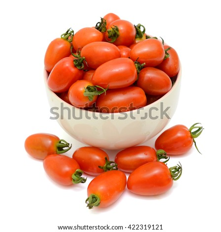 Ripe cherry tomatoes fruits in bowl isolated on white background - stock photo