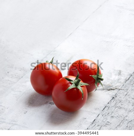 Ripe Cherry Tomatoes on white wooden background - stock photo