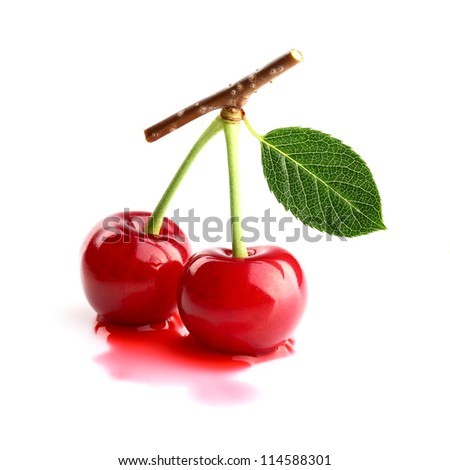Ripe cherry with leaf - stock photo