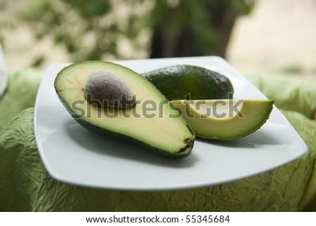ripe chopped avocado on a white plate - stock photo