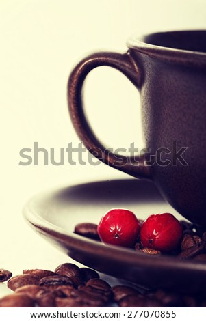 Ripe coffee berries on a plate - stock photo