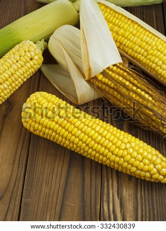 ripe corn on wooden table