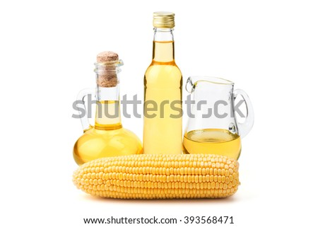Ripe corn with vintage glass bottles of oil isolated on white background - stock photo