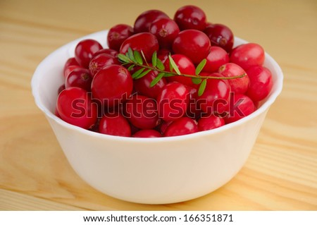 Ripe cranberries with leaves - stock photo