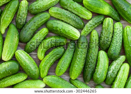 Ripe cucumbers texture on wooden table
